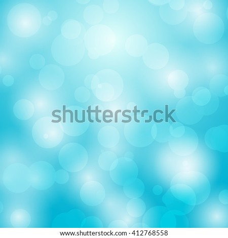 Abstract background with bokeh circles on blue background