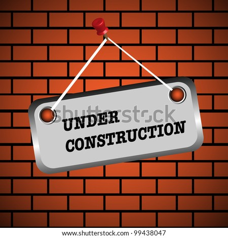 Abstract colorful background with an under construction sign on a brick wall