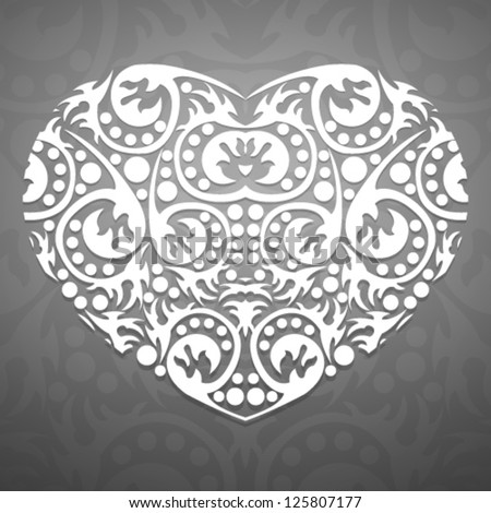 Abstract pattern heart of floral scrolls on a gray background