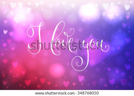 Abstract smooth blur blue and pink background with heart-shaped lights over it and hand written I love you words.