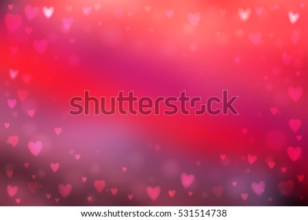 Abstract smooth blur pink background with small heart-shaped lights over it.
