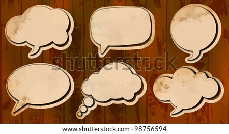 Aged cut out speech bubbles - stock vector
