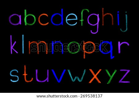Alphabet hand drawn with colour pencils. Sketched letters in childish style on black background. Vector illustration