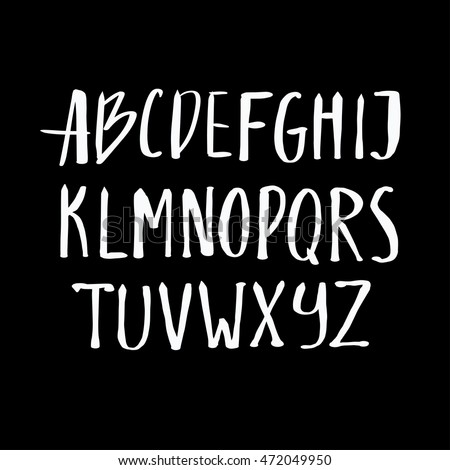 Alphabet letters.White handwritten font drawn with liquid ink and brush.Calligraphic script