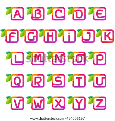 Alphabet square with juice and green leaves.