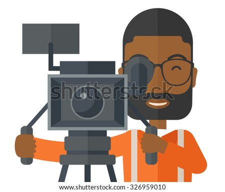 An african-american cameraman with beard and glasses looking through movie camera on a tripod vector flat design illustration isolated on white background. Horizontal layout. - stock vector
