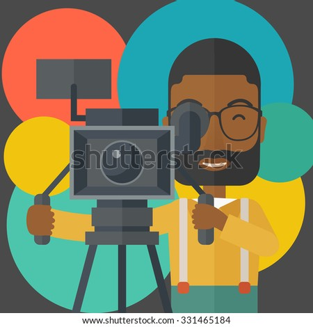 An african-american cameraman with beard and glasses looking through movie camera on a tripod vector flat design illustration. Square layout. - stock vector