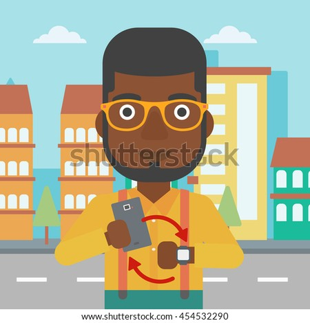 An african-american man holding smartphone and looking at his smart watch. Synchronization between smartwatch and smartphone. Vector flat design illustration. Square layout. - stock vector