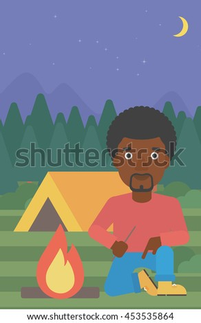 An african-american man kindling a campfire on the background of camping site with tent. Tourist relaxing near campfire. Vector flat design illustration. Vertical layout. - stock vector