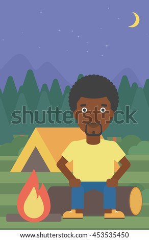 An african-american travelling man sitting on a log near a fire on a background of camping site with tent. Man sitting near a campfire at a campsite. Vector flat design illustration. Vertical layout. - stock vector
