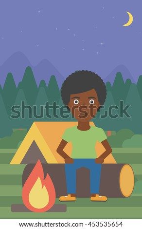 An african-american woman sitting on a log near a fire on a background of camping site with tent. Woman sitting near a campfire at a campsite. Vector flat design illustration. Vertical layout. - stock vector