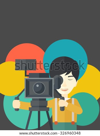 An Asian cameraman looking through movie camera on a tripod vector flat design illustration. Vertical layout with a text space.