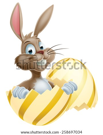An cute cartoon Easter bunny peeking out of a gold egg  - stock vector