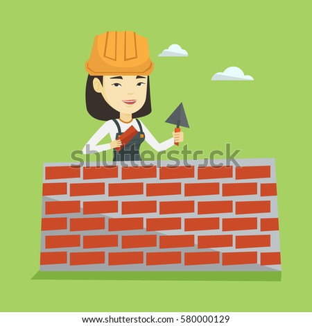 Asian Female Bricklayer In Uniform And Hard Hat Young Bicklayer Working With Spatula Brick