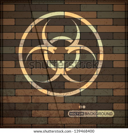 Background with biohazard symbol on brick wall