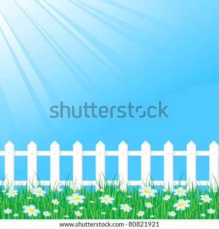 Background with grass reflecting the rays of light and white fence