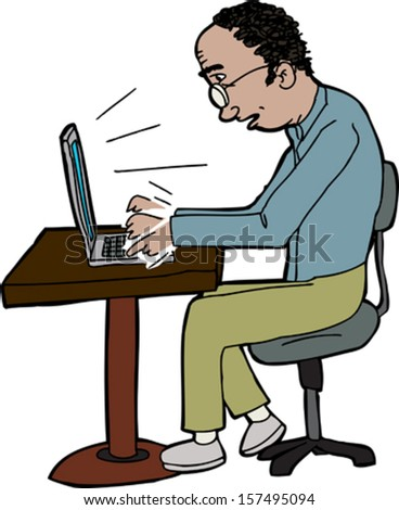 Balding man typing on laptop on small table