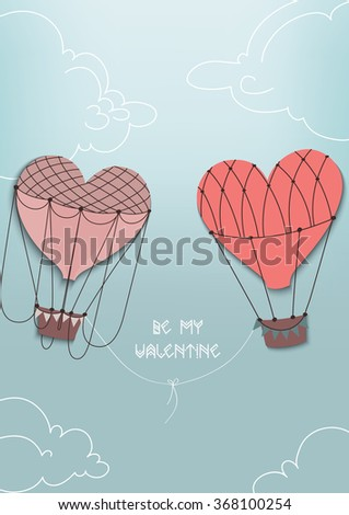 Balloons - heart fly together in the clouds and blue sky