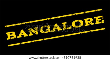 Bangalore watermark stamp. Text caption between parallel lines with grunge design style. Rubber seal stamp with scratched texture. Vector yellow color ink imprint on a blue background.