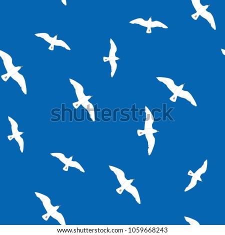 Beautiful flying seagulls in the blue sky seamless pattern