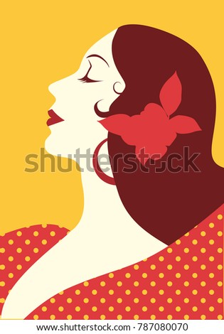 Beautiful spanish woman with flower in her hair and polka dot dress wearing big circular earrings