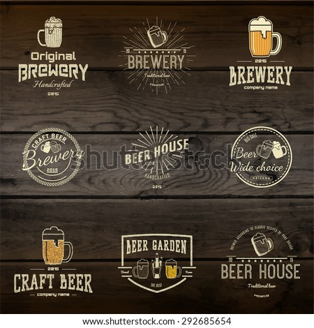 Beer badges logos and labels for any use, logo templates and design elements for beer house, bar, pub, brewing company, brewery, tavern, restaurant, on wooden background texture - stock vector