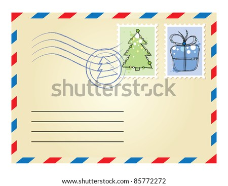 beige xmas envelope with postage stamps on white background