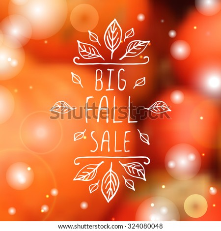 Big Fall Sale. Hand-sketched typographic element with orange leaves on blurred background.  - stock vector