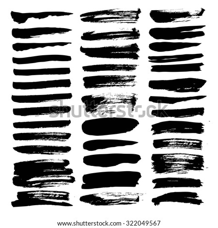 Big set of thin smears of thick black ink isolated on a white background