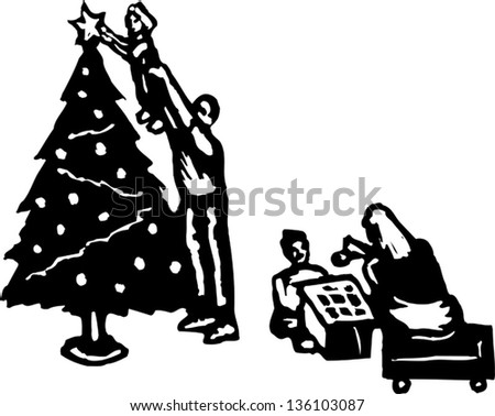 Black People Decorating For Christmas family decorating christmas tree stock photos, royalty-free images