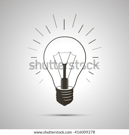 Black simple light bulb icon with shadow on white background