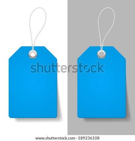 Blank blue price tags on white and grey background