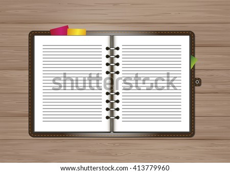 Blank notepad on a wooden table top view
