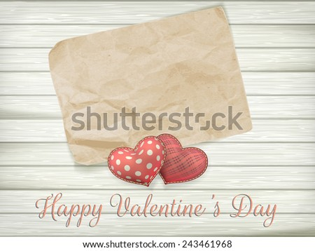 Blank old piece of paper and vintage handmaded valentines day toy hearts over wooden background. EPS 10 vector file included - stock vector