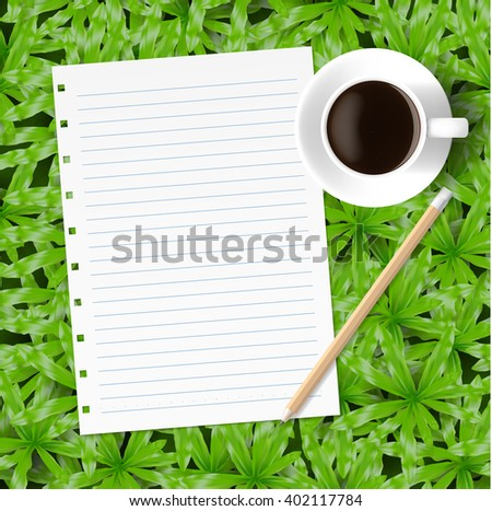 blank paper with pencil and coffee on green grass