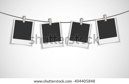Blank photo frames hanging on the metallic clip