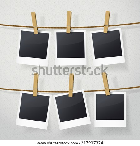 blank photo frames on rope over white background - stock vector