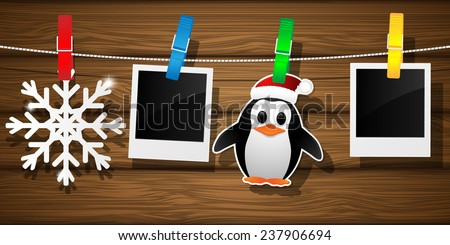 Blank photo frames, penguin and snowflake on a clothesline. Vector illustration.  - stock vector