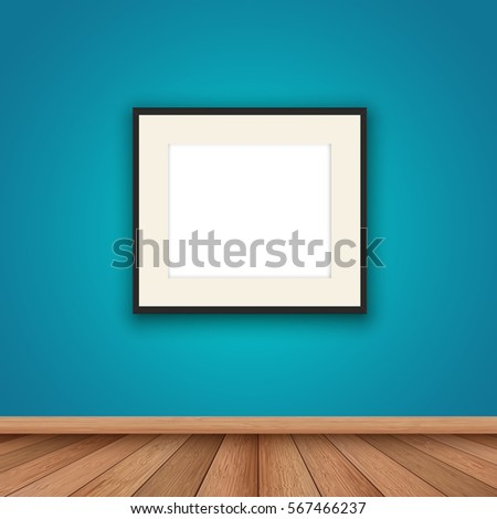 Blank picture frame hanging on a wall in a room interior