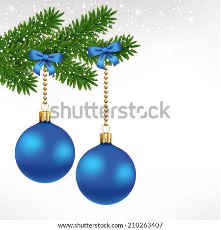 Blue christmas balls on fir tree with ribbon