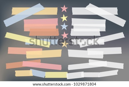 Blue, red, yellow adhesive, sticky, masking, duct tape, paper pieces for text with stars on dark gray background.