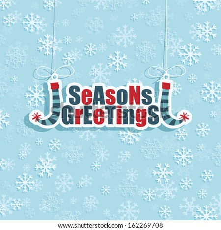 blue snowflake background with hanging christmas decoration, eps 10 format with transparencies. - stock vector