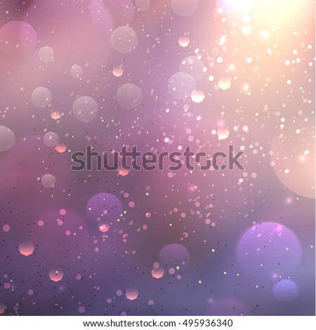 blurred background with soft lilac colors and fine sparkles of light.