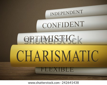 book title of charismatic isolated on a wooden table over dark background - stock vector