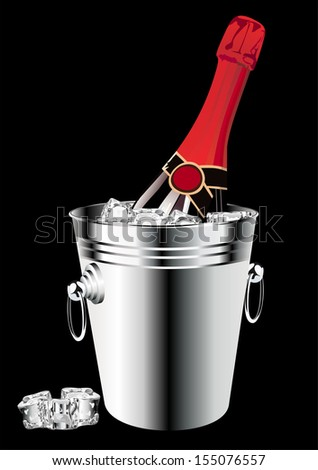 Bottle of champagne in bucket isolated on black