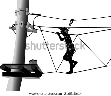 boy in adventure park rope ladder