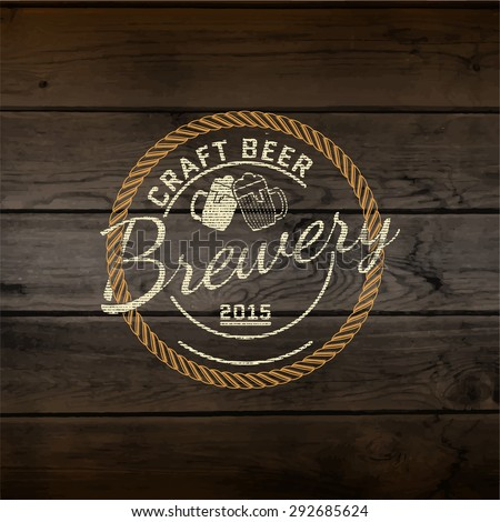 Brewery badges logos and labels for any use, logo templates and design elements for beer house, bar, pub, brewing company, brewery, tavern, restaurant, on wooden background texture - stock vector