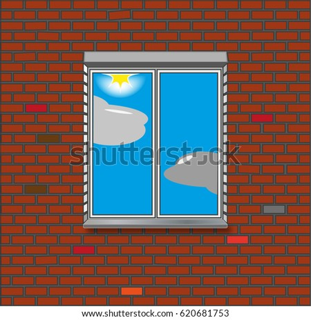 Brick wall with a window. Reflection of the sun and clouds in the window glass.