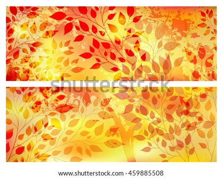 Bright autumn abstract background with casebound leaves and branches