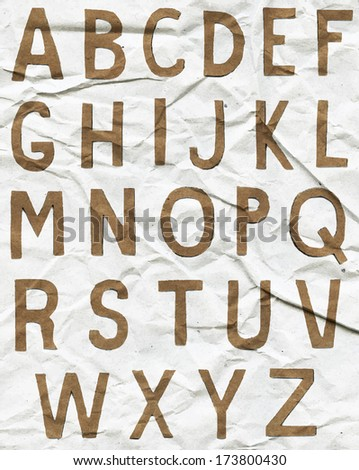 Brown vector alphabet letters on crumpled paper - stock vector
